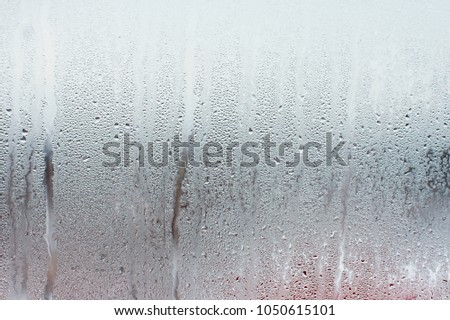 Water droplets condensation background of dew on glass window, humidity and foggy blank background. Outside the window, bad weather, rain