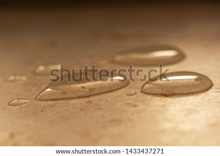 Water droplets lying on a marble surface