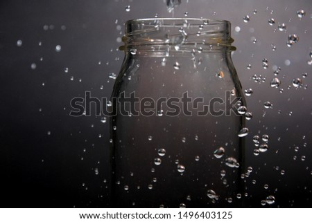 Water droplets on a black background.