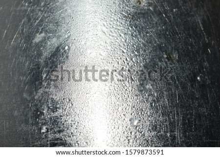 Water droplets on a silver background