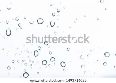 Water droplets on a white background