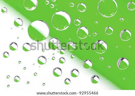 Water droplets on a white-green background. Macro shot.