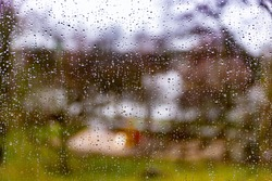 Water droplets on a window with blurr background.