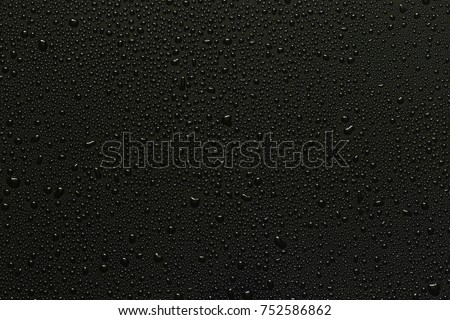 Photo of  Water droplets on black background
