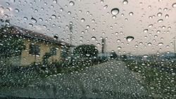 Water droplets on car glass. Rainy days.