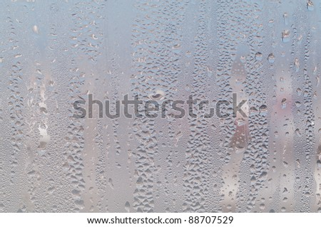 Water droplets on glass. Condensate due to high humidity.