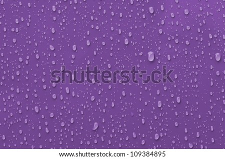 Water Droplets on Pink metallic Surface