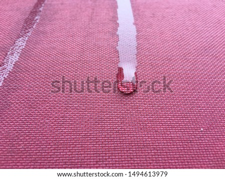 Water droplets on red background