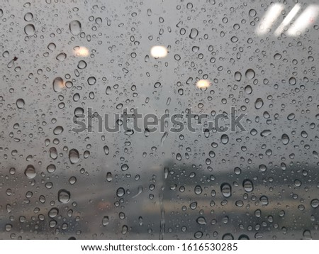 Water droplets on the glass.