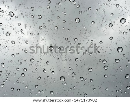 Water droplets on the glass and blurred background.