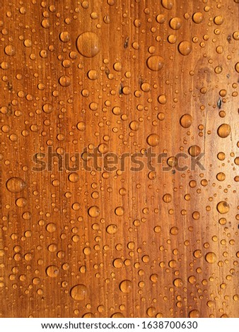 Water droplets on the wood plate