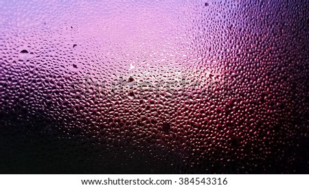 stock-photo-water-droplets-on-window-in-