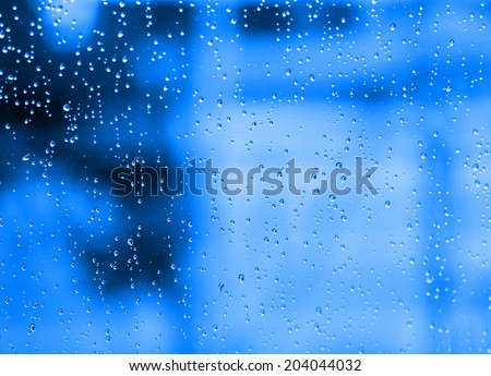 Water dropped on blue filtered background.