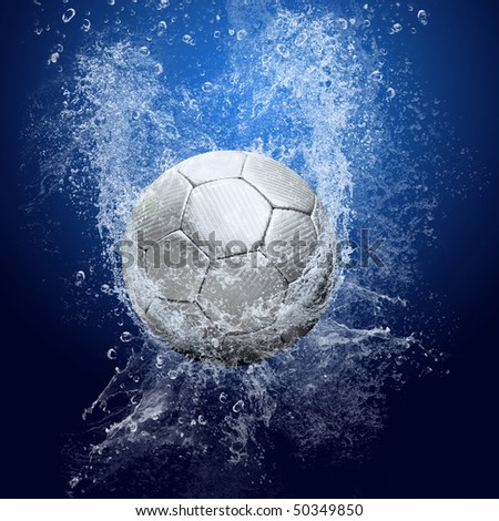 Water drops around soccer ball on blue background