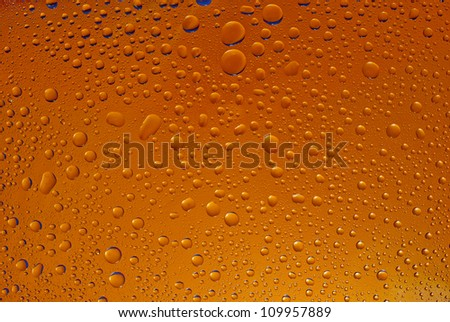 Water drops background, covered with water drops - condensation, close - up. Orange gradient background.