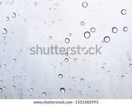 Water drops background , rain drops on glass #1501682993