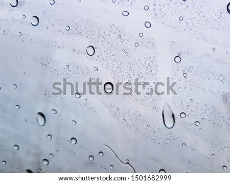 Water drops background , rain drops on glass #1501682999