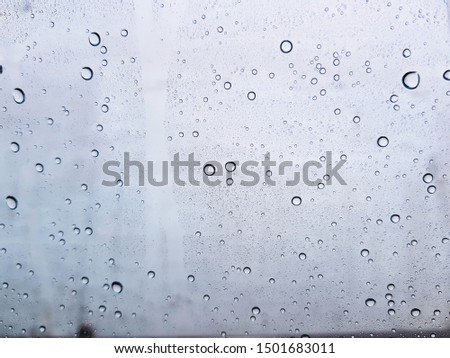 Water drops background , rain drops on glass #1501683011