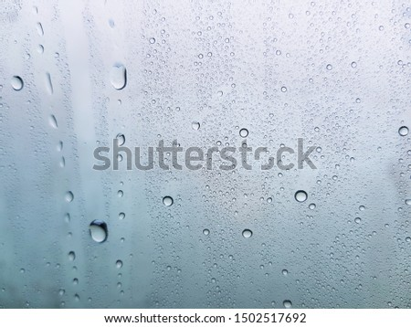 Water drops background , rain drops on glass #1502517692