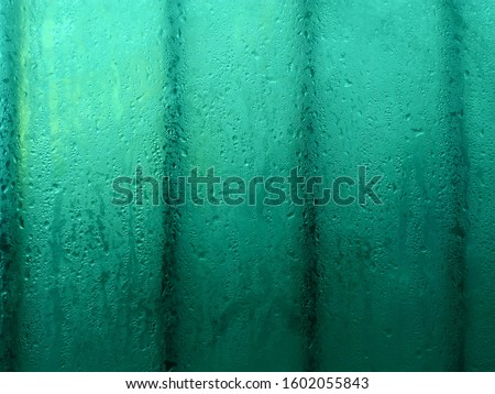 Water drops condensation on window & bars clear aqua menthe glass background texture. Blue droplets. Water drops after rain on prison window in aqua menthe color. Dew water drops on wet window closeup Stock photo ©