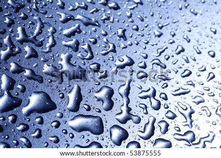 Water drops macro on metal surface, may be used as abstract background