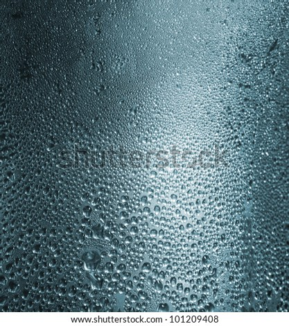 Water drops on a metallic background. Close up