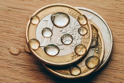 Water drops on a stack of Euro coins - exchange rates - financial autumn