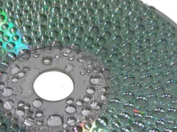 water drops on a surface of compact disc 5