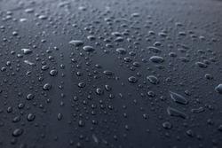 Water drops on a waterproof surface