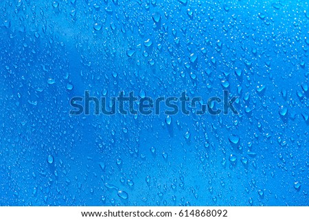 Water drops on blue metal background. Abstarct blue wet texture #614868092