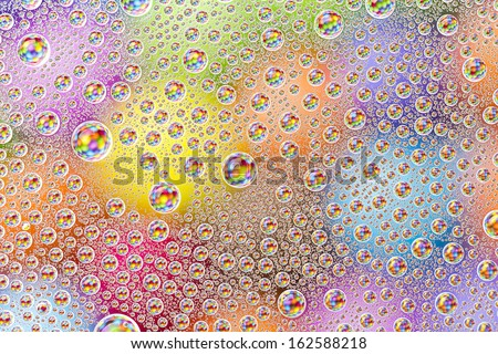 water drops on colorful orange blue yellow sweet candy Sugar love pearls refraktion background