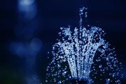 Water drops on dark blue background
