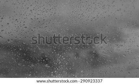 Water drops on glass in monochrome #290923337