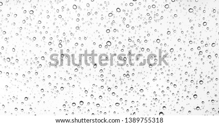 Water drops on glass or rain drop #1389755318