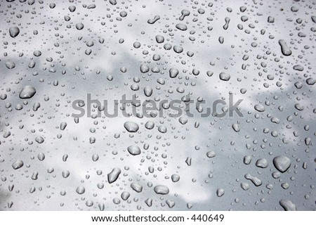 Water drops on metalized car paint, hence the tiny grain-looking dots on the surface