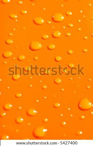 water drops on orange metal macro background