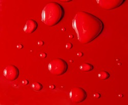 Water drops on red