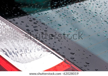 water drops on the surface of a blue car