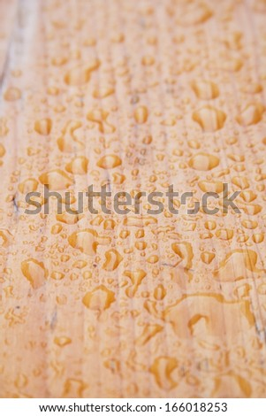Water drops on the wooden table after the rain