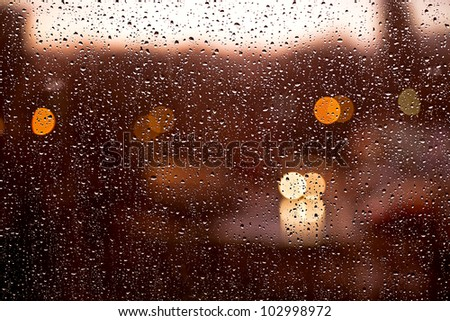 water drops on window by evening
