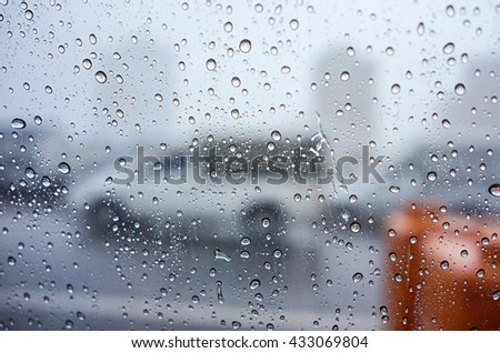 Water drops on window glass, blurred on the edges #433069804