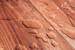 water drops on wooden board closeup