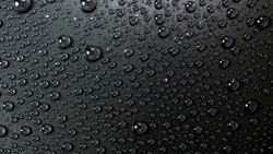 Water drops rain or droplet on black background. Condensation is the process of a substance in a gaseous state transforming liquid.