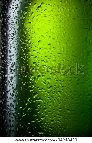 Water drops texture on the bottle of beer. Abstract background with selective focus