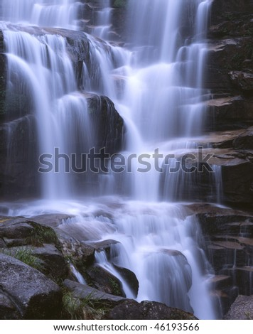 Water falls in waterfall, beauty in nature.