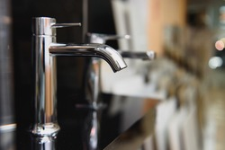 Water faucet, bathroom faucet and kitchen faucet. Chrome-plated metal.