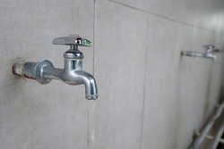 water faucet or  water tab on ceramic wall