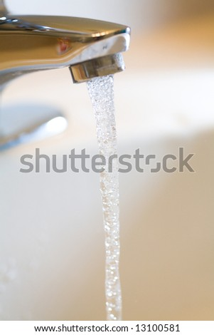 water Faucet /tap and Running Water close up shot