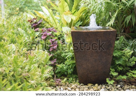 water feature in garden is Chinese belief   fountain from pot  put on right front of house is lucky