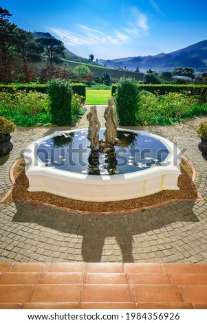 Water feature with statues, mountain and blue sky backdrop   Mont Rochelle (Richard Branson's wine farm)  Franschhoek, Cape Town Stock photo ©
